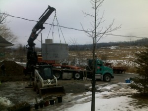 2 Picking up cistern with Crane truck