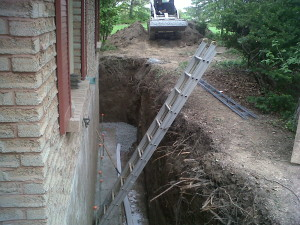 1 Excavate wall and pour wider footing New gravel