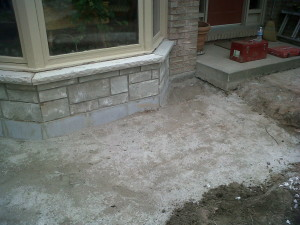 5 Repair to foundation beneath bay window.